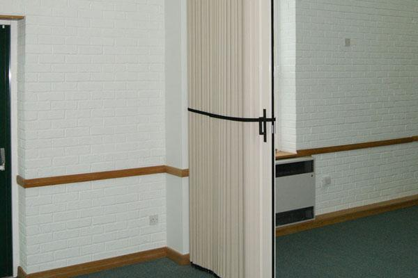 folding partition door tied back
